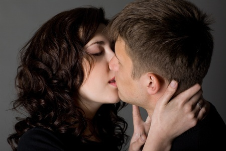 Young People Kissing